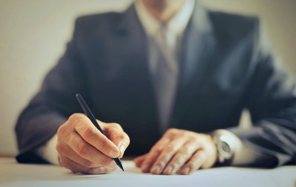 image of attorney with a pen